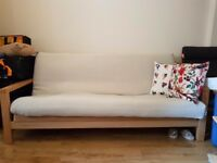 Futon Company 3 seater sofa bed -- brand new condition, mattress & cover included