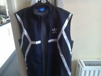 Brand New Adidas running body warmer.