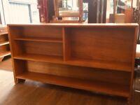 Large mid century light oak open bookcase .