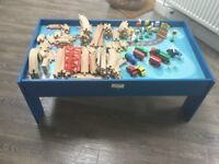 Train table with wooden track and trains