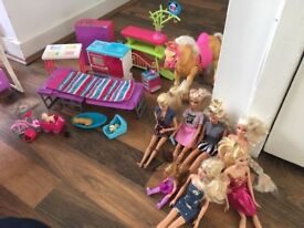 Barbie Dreamhouse with lots of the accessories. Also Barbie dolls plus camping furniture p