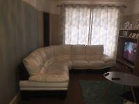Leather corner sofa black and white