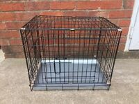 SMALL 2 DOOR DOG CRATE , 23 INCHES LONG, 16 INCHES WIDE AND 19 INCHES TALL