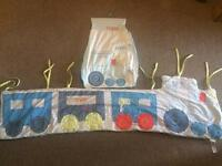 Cot bumpers and nappy storage bag