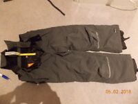 ski trousers salopettes size 128cm which is about size 7, 8 or 9 years. Icepeak brand