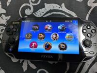 Ps VITA with 16gb memory card, cover , screen protector 2 x chargers and 10 games