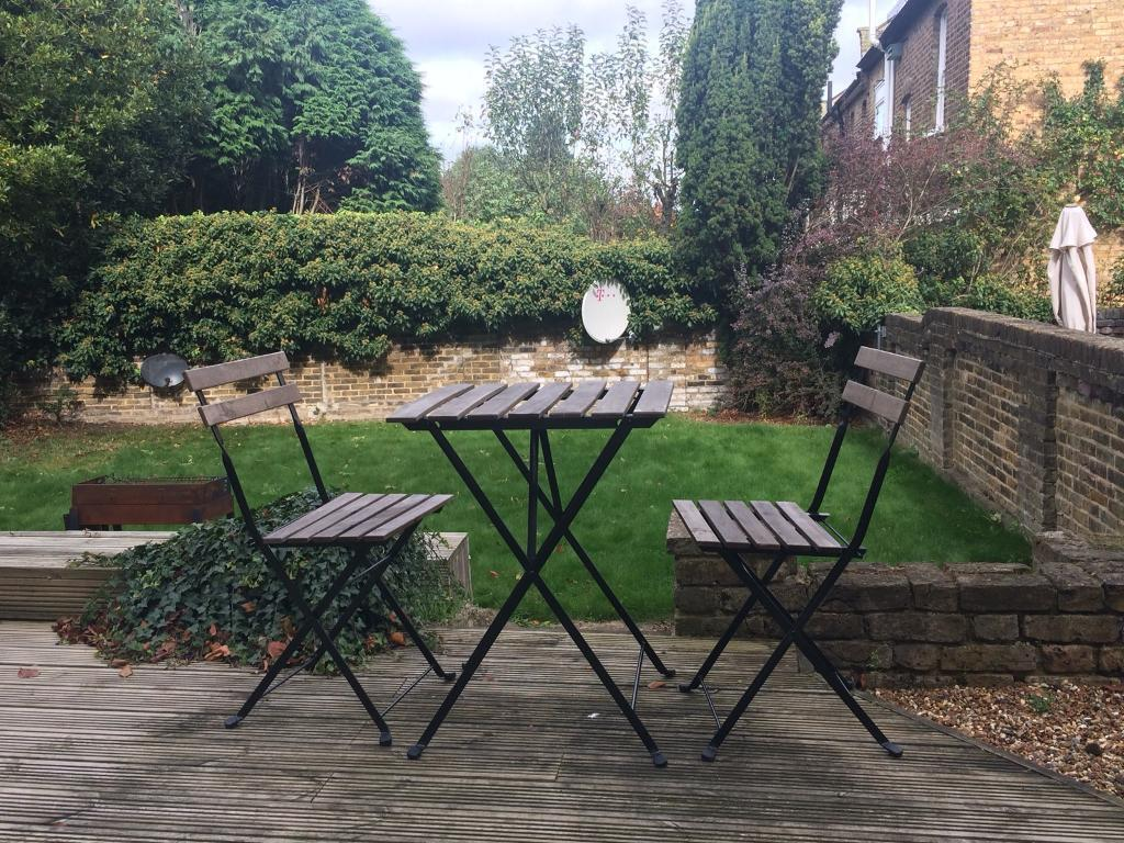 Wooden garden table with chairs