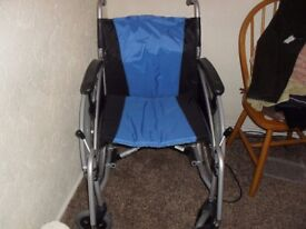 Exel Vanos push along wheel chair with foot plates