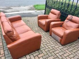 Beautiful leather suite with electric recliner