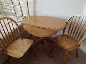 Pine kitchen table and 2, chairs immaculate