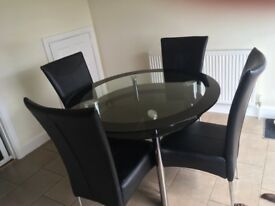 Black and clear glass dining table and 4 x chairs