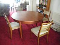 Light oak round dining table and 4 chairs