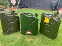Three Jerry cans with two funnels