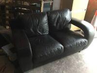 Small Designer modern leather sofa
