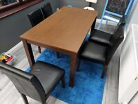 Dark brown dining table and chairs