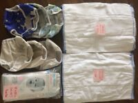 Bundle of preowned Medium Cottom Bottom nappies. 18 liners (6 new), 6 outers