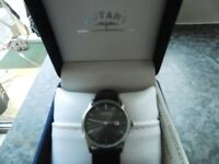 MANS ROTARY WATCH BLACK DIAL BRAND NEW IN PRESENTAION BOX