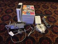 Used Wii with 10 games and nunchucks, no chargers included