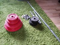 Assorted size metal weights and barbell totalling over 33 kilos. Can deliver.