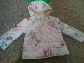Next quilted coat 12-18 months. Worn once. New conditon