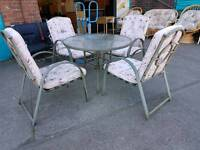 Metal glass top garden table and 4 chairs