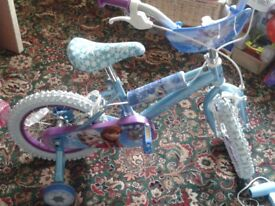 """14"""" Frozen bicycle and helmet, excellent condition, both only used for 1hr"""