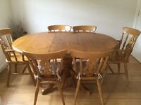 Oval, extending, farmhouse style dining table and 6 chairs(incl 2 carvers)