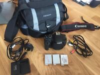 Canon 550d dslr camera with batteries and bag