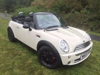 Mini Cooper convertible 55 reg in polar white with full electric roof and black leather trim