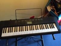 Electric keyboard and stand SOLD