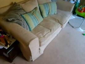 Two matching cream fabric sofas with foot stool