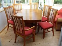 Teak coloured dining suite. Table, 4 chairs plus 2 carvers recent new upholstery extra table leaf