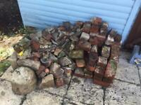 House bricks. Some whole. Some half. Some rubble