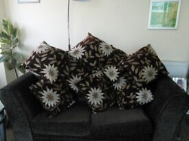 Cushion brown Goldy flower pattern good clean condition can be washed eight in total