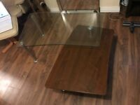 Glass coffee table for sale £25, with wood under table and chrome legs, no longer needed