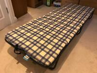 Folding bed with foam mattress
