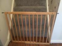 2 extendable wooden stair gates.