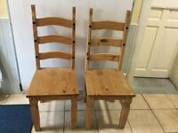 Two farmhouse wooden chairs