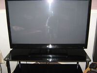 42 inch lg flatscreen with tv stand in black glass