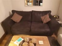 The sofa is less then 2 years old. Leather effect fabric and approximately 1800mm(L) x 900mm(D)