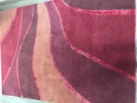 Red and orange wool rug - excellent condition