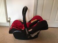 Maxi cosi baby car seat with plastic rain cover