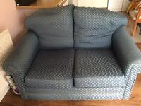 Blue 2 seater sofa with worn arms, Glos