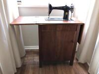 Singer Treadle Sewing Machine in Wooden Cabinet