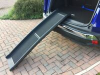 Foldable pet ramp to help your pets run up and into your vehicle condition as new