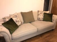 Beautiful 4 seater cream fabric cushion back sofa with studded detail to arms
