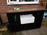 Wooden bar with belfast sink