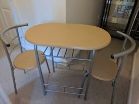 Table and chairs £20