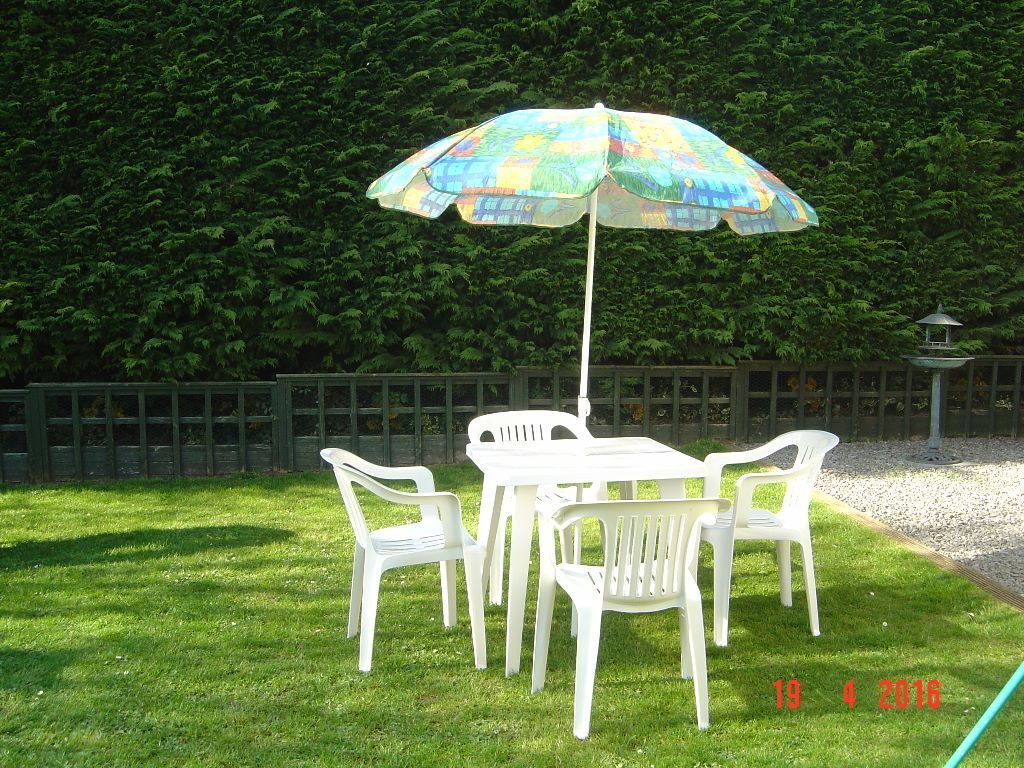 white plastic patio set four chairs table and parasol can deliver - Garden Furniture Yate