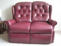 2 leather 2 seater sofas.